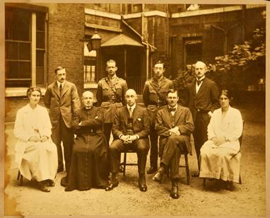 Photograph of the St George's Hospital residential house staff, with two of the Medical School's first female students, 1917